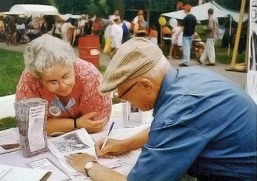 Barre Historical Society member Marjorie Power looking at the brochure with Salvatore Savinelli