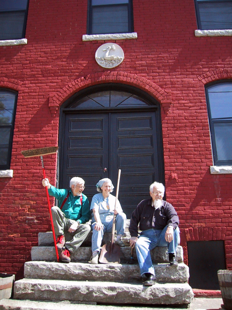 The late Chet Briggs, Karen Lane, and the late Mario Barberi, members of the Barre Historical Society's hard working Board, resting on the steps of the Old Labor Hall after a work day