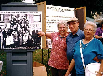 Barre Historical Society member Marjorie Power pointing at Angelo Savinelli in the picture