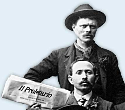 "Two men hold a copy of ""Il Proletario"" on Primo Maggio 1905"