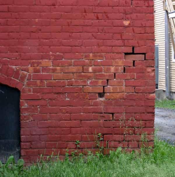 deteriorated brickwork on rear of Hall