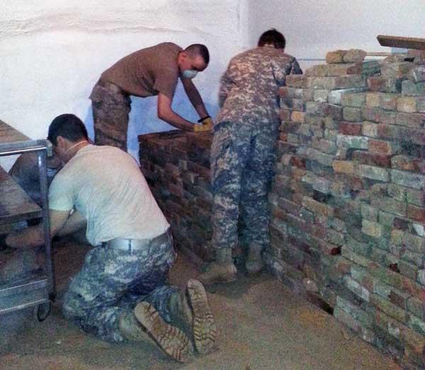 Norwich University cadet volunteers stacking bricks