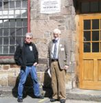Si Kahn with Chet Briggs in front of the Stone Mill in Lawrence, Massachusetts