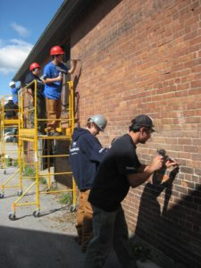YouthBuild team working on the Bakery brickwork