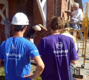 YouthBuild students watch demonstration at Historic brick workshop