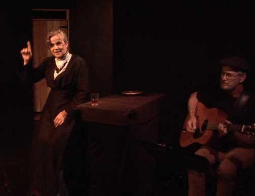 Vivian Nesbitt as Mother Jones in jail with John Dillon