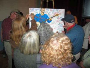 Audience signing Pete Seeger's 90th birthday card 2009
