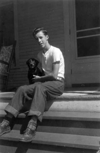 Young Tom with dog