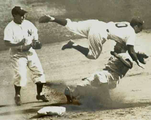 Jackie Robinson stealing a base from Phil Rizzuto in the 1947 Wold Series