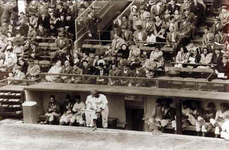 Jackie Robinson in the dugout before his first at bat in the Major Leagues -1947