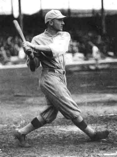 Lary Gardner swinging a bat