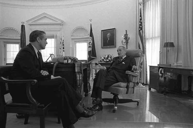 Sargent Shriver talking wth President Johnson