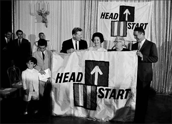 Lady Bird Johnson and Sargent Shriver at ceremony for National Head Start Day, with Danny Kaye, and Mrs. Lou Maginn (Director of a HeadStart project in East Fairfield, Vermont), - June 30, 1965.